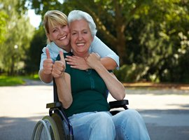 rsz_nurse_with_lady_in_wheelchair.jpg